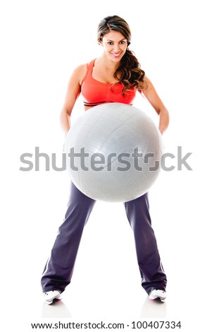 Woman exercising with Pilates ball - isolated over a white background