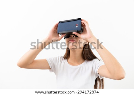 Woman experience though the visual reality device - stock photo