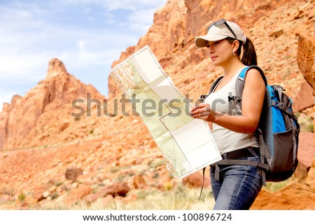 Woman exploring at the Grand Canyon with a map - stock photo