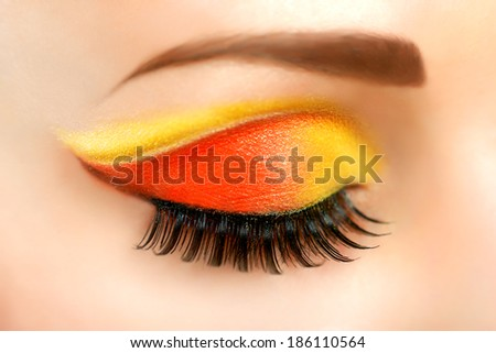 Woman eye with beautiful fashion brigh makeup - stock photo