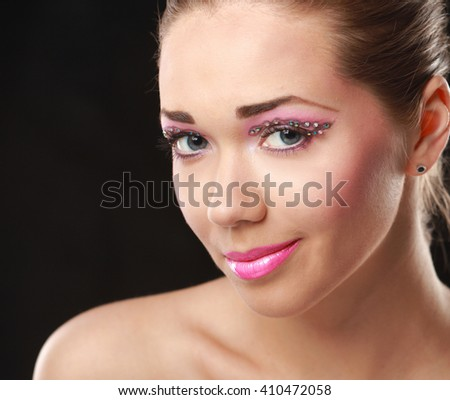 Woman eye with exotic style makeup
