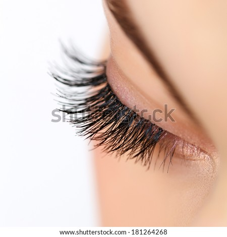 Woman eye with  long eyelashes. Eyelash extension - stock photo