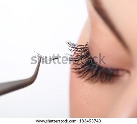 Woman eye with long eyelashes. Eyelash extension - stock photo