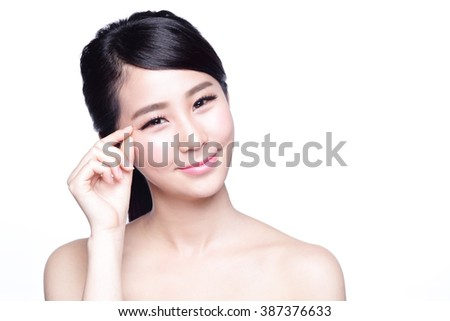 Woman face and eye care and she touch eye with hands, asian beauty