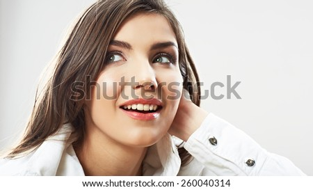 Woman face close up white background isolated. Smiling girl portrait. Female model studio poses. - stock photo