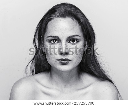 Woman  face freckled young beautiful healthy skin and long hair portrait black and white - stock photo