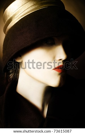 Woman face in black hat. Artistic portrait of beautiful woman in black hat - stock photo