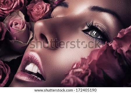 woman face in pink roses