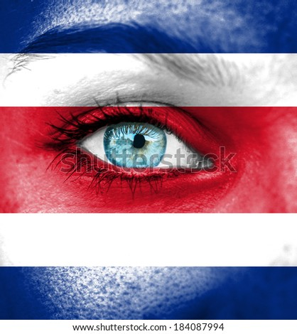 Woman face painted with flag of Costa Rica