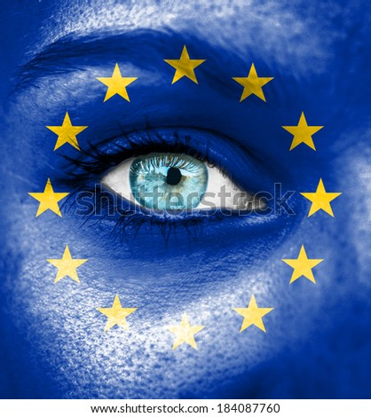 Woman face painted with flag of European Union