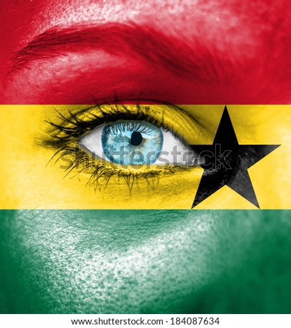 Woman face painted with flag of Ghana