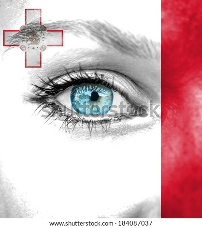 Woman face painted with flag of Malta