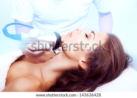 woman face treatment in medical spa center - stock photo