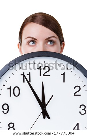 Woman face with a big clock isolated on a white background - stock photo