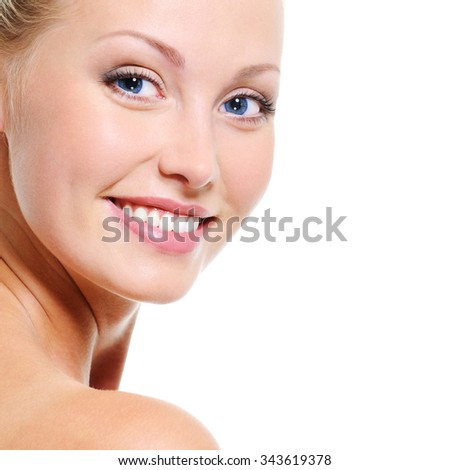 Woman face with a nice smile and healthy beautiful clear skin over white backgrouns - stock photo