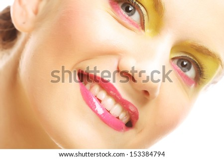 Woman face with bright makeup - stock photo