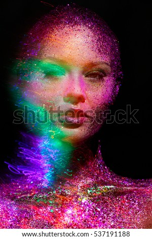 Woman face with colorful luxury bodyart