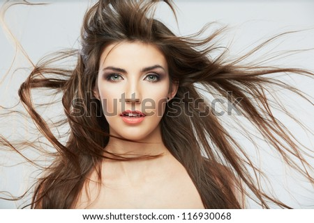 Woman face with hair motion on white background isolated close up portrait.