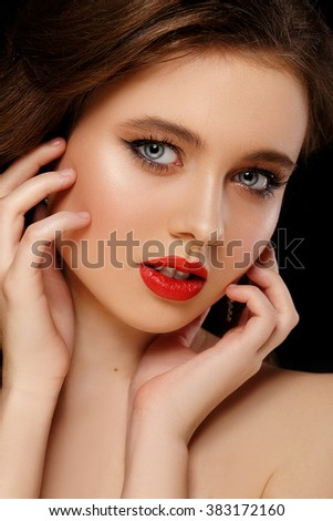 Woman face with red lips. Beauty and Fashion. Portrait of a beautiful young girl - stock photo