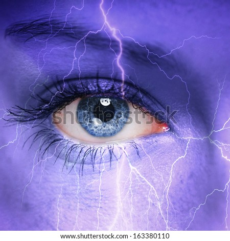 Woman face with thunderstorm painted on it - nature concept - stock photo