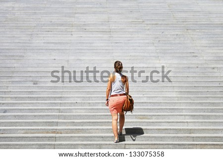 Woman facing a challenge. - stock photo
