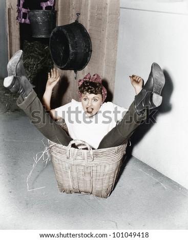 Woman falling into basket - stock photo