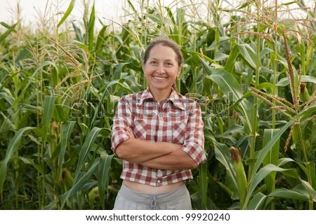 woman farmer in a field of corn cobs - stock photo