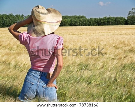 woman farmer in a wheat crop - stock photo
