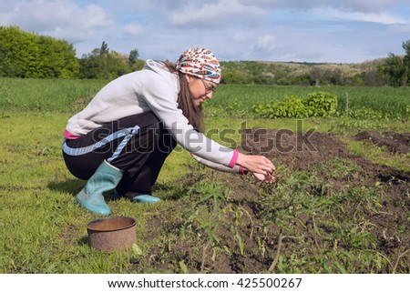 Woman farmer working in the field and she is happy.