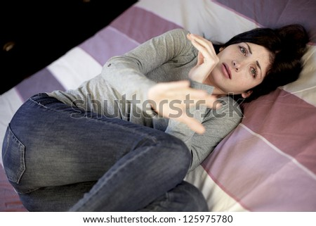 Woman fear of being hit and violence of man - stock photo