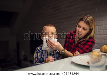 Woman feeding her son at home.
