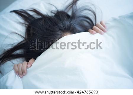 Woman feel fear under blanket. - stock photo