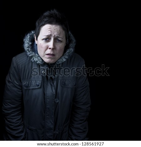 Woman feeling cold at night portrait with copy space and black background