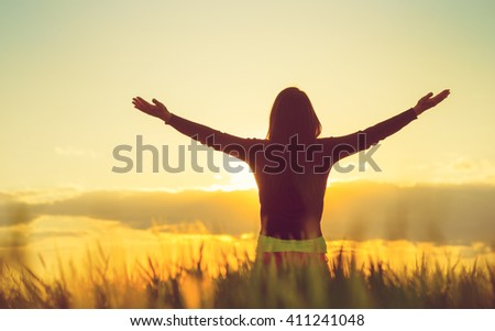Woman feeling free in a beautiful natural setting. - stock photo