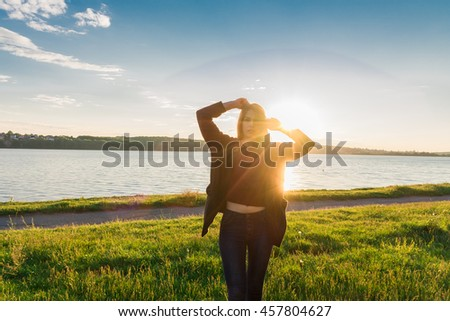Woman feeling free in nature lake sun outdoor