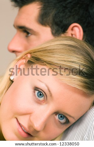 Woman feeling protected leaning at the shoulder of her guy