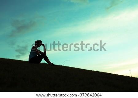 Woman feeling sad and alone. - stock photo