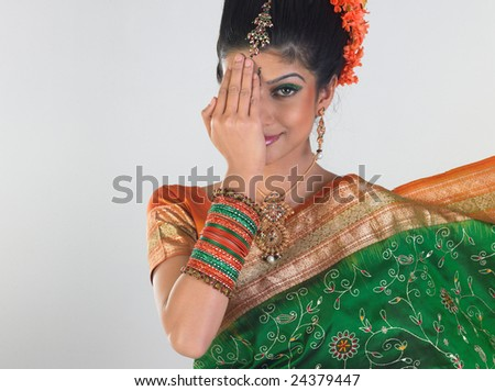 Woman feeling shy expression in bridal costume