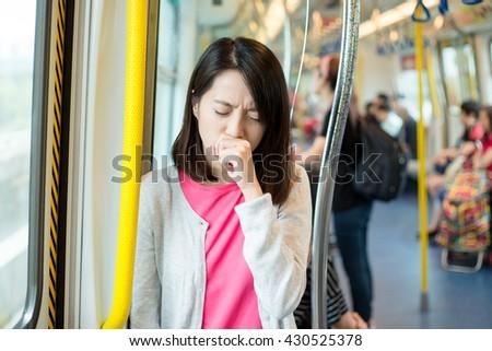 Woman feeling unwell inside train  - stock photo