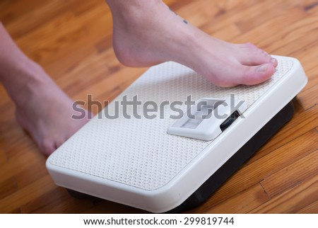 Woman feet and time for weight truth from a scale