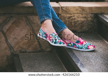woman feet in colorful summer espadrilles on stairs outdoor shot