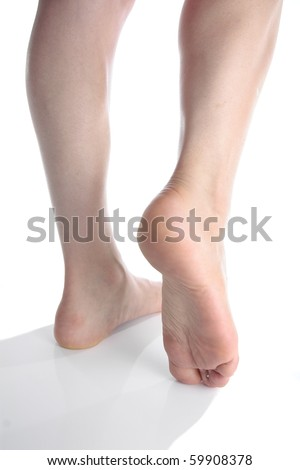 Woman feet isolated over white