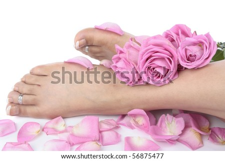 Woman  feet legs and flowers  over white