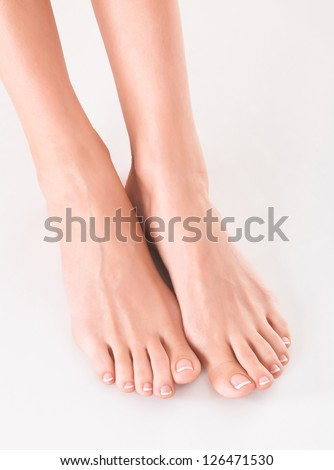 woman feet on white - stock photo