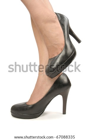 Woman feet with black high heels