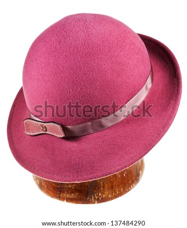 woman felt magenta hat with wide brim on wooden block isolated on white background