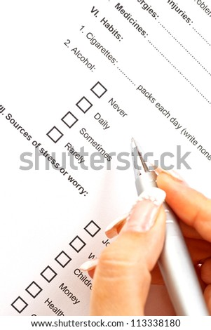 Woman filling the medical history questionnaire