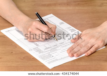 Woman fills the documents