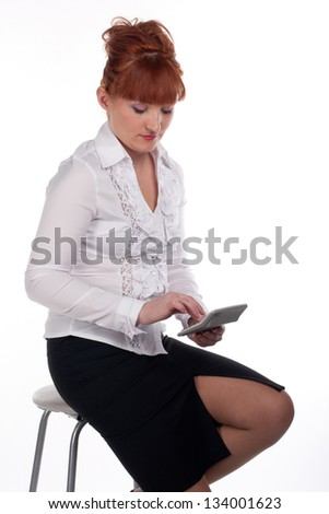 woman finds a calculator sitting on a white background