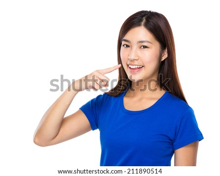 Woman finger point to teeth